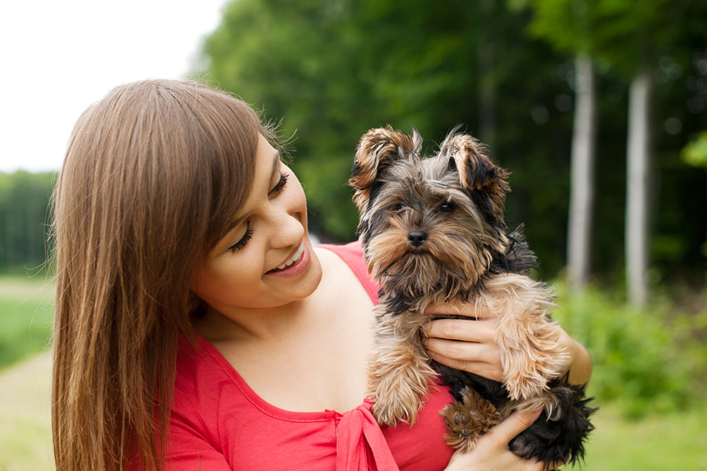 Smiling Woman with Small Dog
